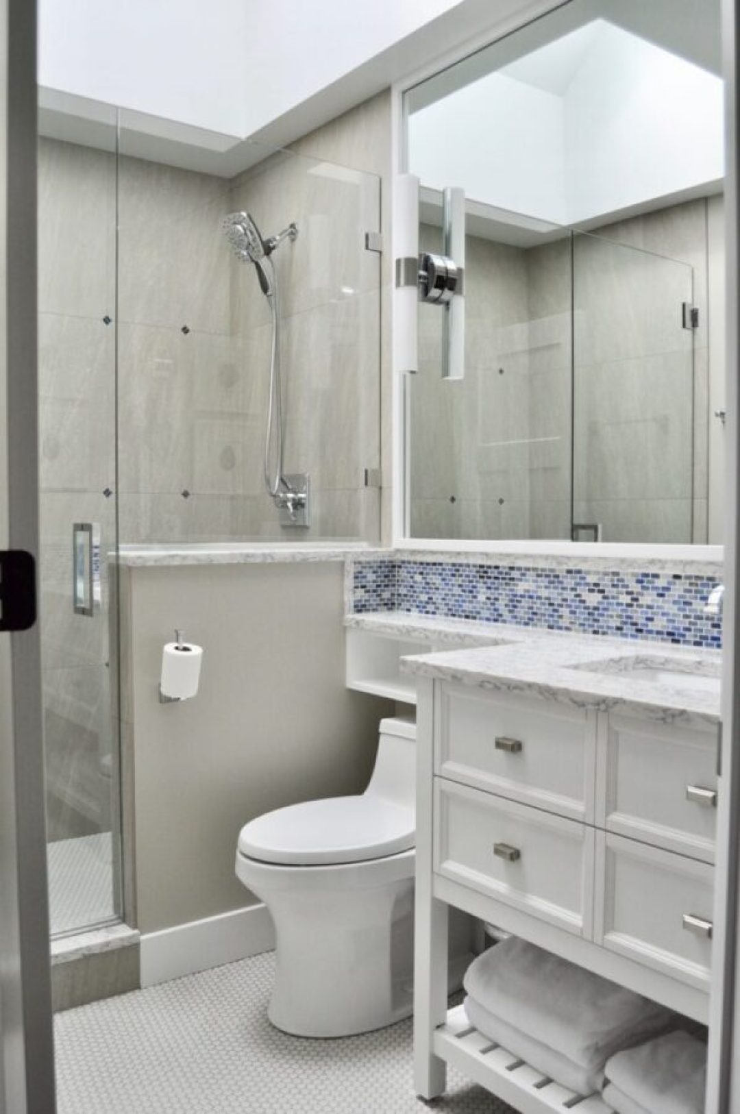 Renovated bathroom with skylight to add in natural light at this Toledo Airbnb