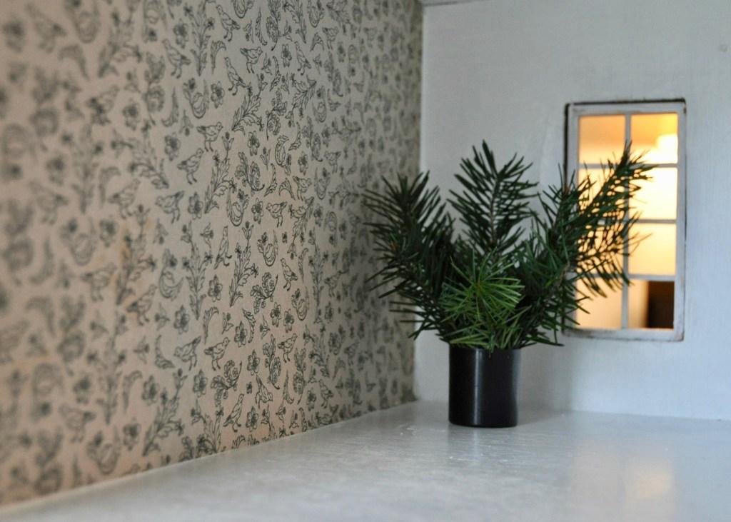 Bedroom with bird wallpaper & DIY plant