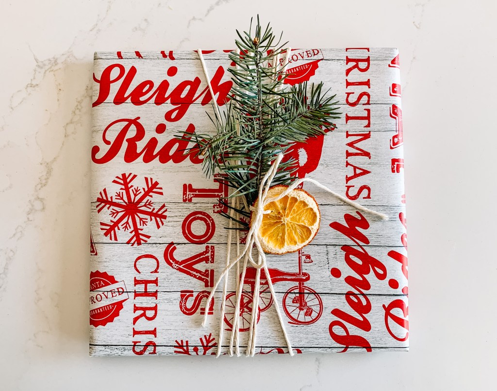 Wrapping a present with dried oranges