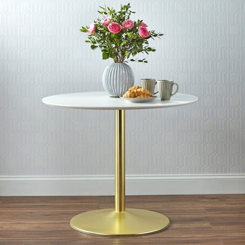 Round table from Overstock with glam fliar