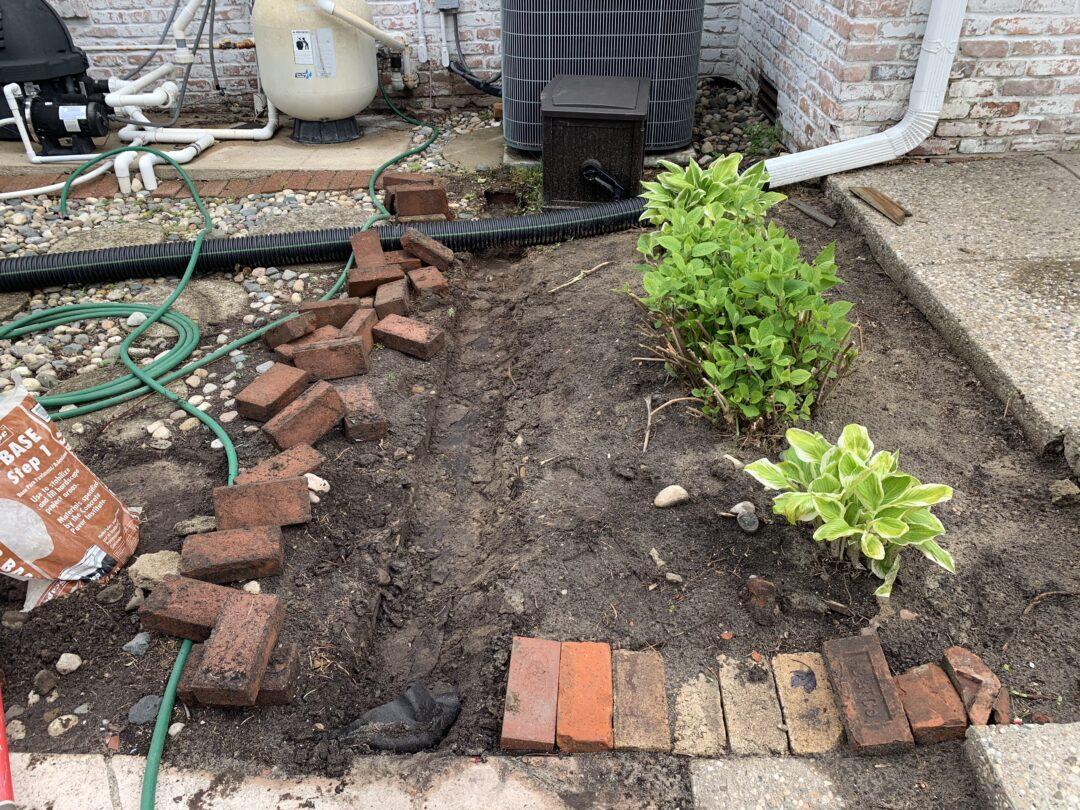 How to easily install a brick border around your flower bed   Building Bluebird #englishgarden #hosta #hydrangea #gardening