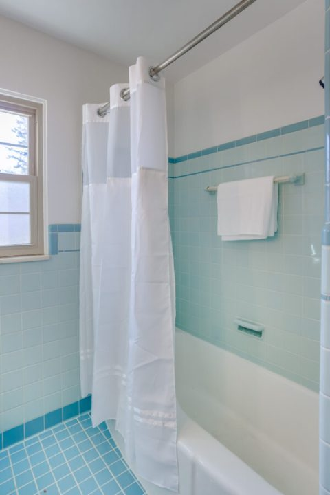 Updating a retro blue bathroom while keeping its charm | Building Bluebird