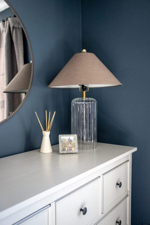 Modern lamp for the moody master bedroom makeover with a glass lamp base and RH Teen lampshade | Building Bluebird #bhgorc #rhteen #targetstyle #ikeahack #rustoleum