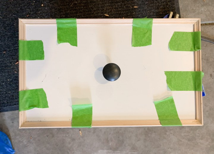 I used FrogTape to keep the trim in place to let the glue dry | Building Bluebird #ikeahack #hemnesdresser #easydiy #bhgorc