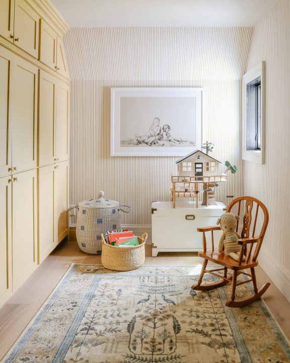 Restrained Gold by Sherwin Williams with playroom design by Chris Loves Julia   Building Bluebird #grandmillennial #cottagecore #yellowpaint