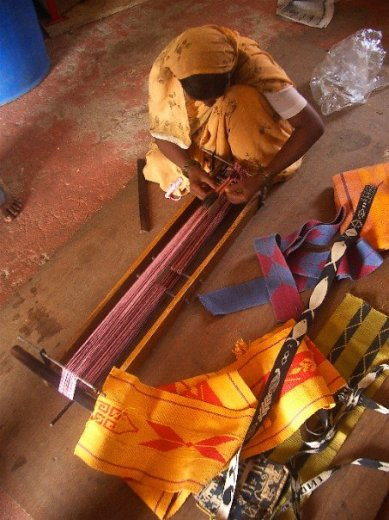 """""""Indian artisan weaves a cloth. Photo by Kathy Ross"""" on Aid to Artisans Facebook page."""