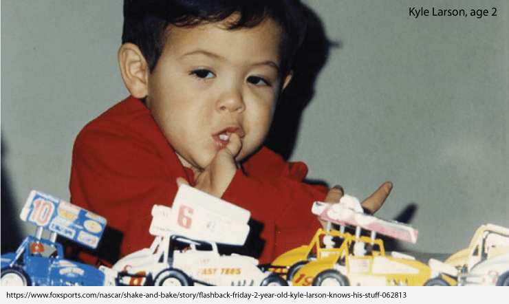 Kyle Larson at two years old, in front of his collections of toy Sprint cars.