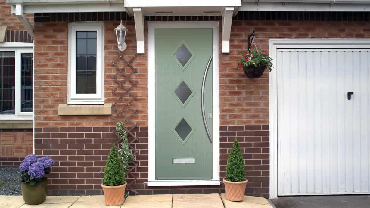 3 diamond style green composite front door in a country style