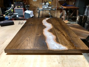 custom made dark wood table top for seattle client with white epoxy pour
