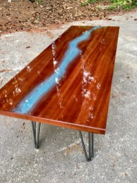 river table with light blue epoxy and hairpin legs