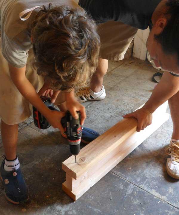 boy-using-drill