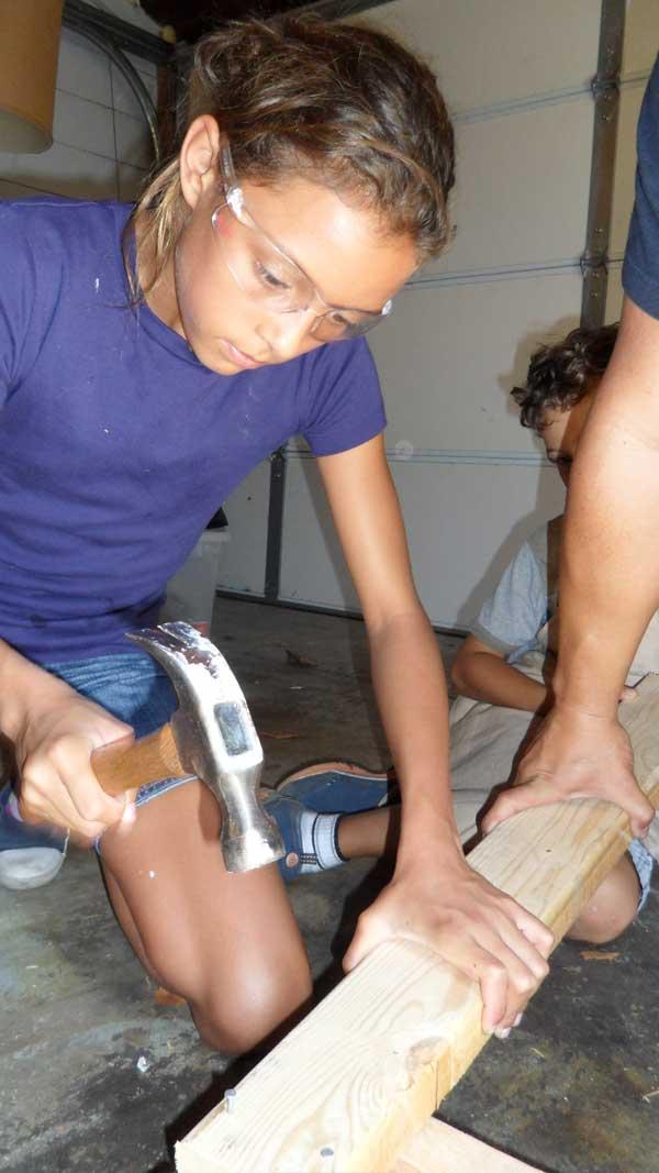 girl-using-hammer