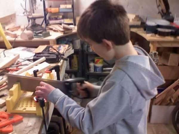 kid-sawing-miterbox