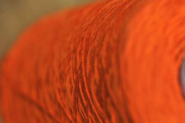 The Stitch orange thread