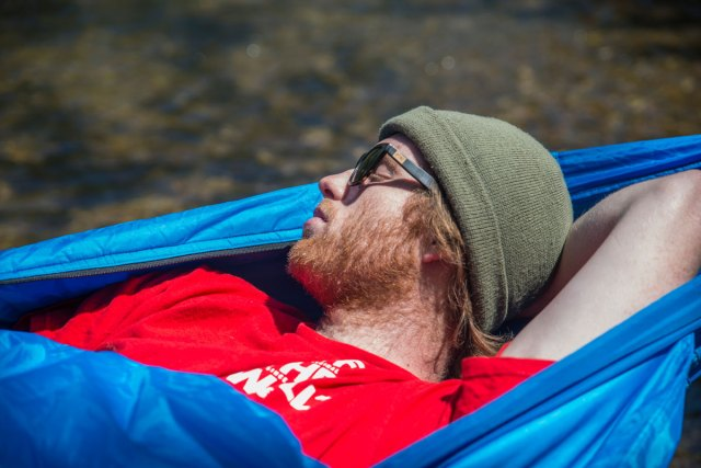 Bison Bag creator Lance Williams sleeping in his hammock