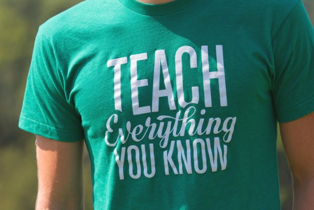 "ConvertKit founder Nathan Barry wearing his ""Teach Everything You Know"" t-shirt"
