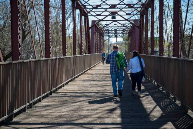 Annalisa and Ken crossing bridge in Boise