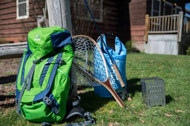 Lone Cone backpack, fishing net and other gear