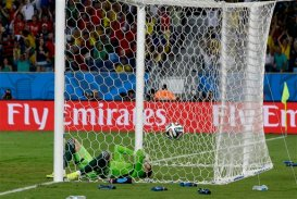 Russia's goalkeeper Igor Akinfeev reacts after letting in the opening goal during the group H World Cup soccer match between Russia and South Korea at the Arena Pantanal in Cuiaba, Brazil, Tuesday, June 17, 2014. (AP Photo/Lee Jin man)
