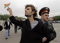 "A Gay Rights protestor is detained by a police officer in Moscow, Russia, Saturday, May 16, 2009. Moscow police have violently dispersed a gay pride parade banned by the authorities. Riot police broke up a protest by around 30 gay pride activists, dragging them into detention buses. Activists called Russia's alleged homophobia ""a disgrace."" (AP Photo/Alexander Zemlianichenko)"