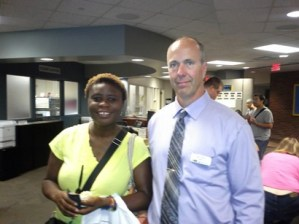 Bukola Oriola and President Kent Hanson of ARCC