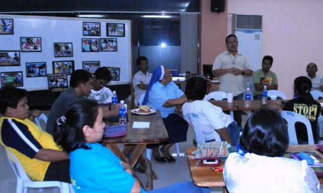 Joel Yadao (in gray shirt) attends an activity of the Rural Missionaries of the Philippines-Northern Mindanao Region in June 2012. (Photo courtesy of RMP-NMR)