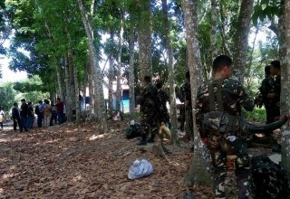 Spotted at the Spottswood Methodist Center are soldiers belonging to the 39th Infantry Battalion patrolling the vicinity since Friday evening. They are posted about 30 meters away from the pastoral house of UMC Bishop Ciriaco Francisco, the resident bishop of the Davao episcopal area. (Photo by Kilab Multimedia)
