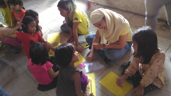 A delegate of the NIHM facilitates a drawing workshop for children evacuees (Contributed photo)