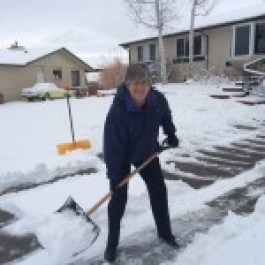 Stormy smiles as she shovels
