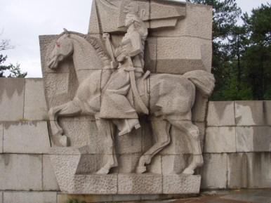 "Raina Kniaginia with ""Liberty or Death"" flag at Panagyurishte Monument."