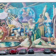 An allegorical work includes local arts professionals depicted as the 9 classical muses depicts the search perfect forms in performance, movement, words, spirit, and more. It is located a block away from the Avenue for the Arts along 13th Street. Call 215-525-1577 and press 7# to hear about this mural.