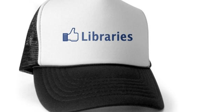 "Photo of library advocacy baseball cap (a thumbs-up with ""libraries"")"