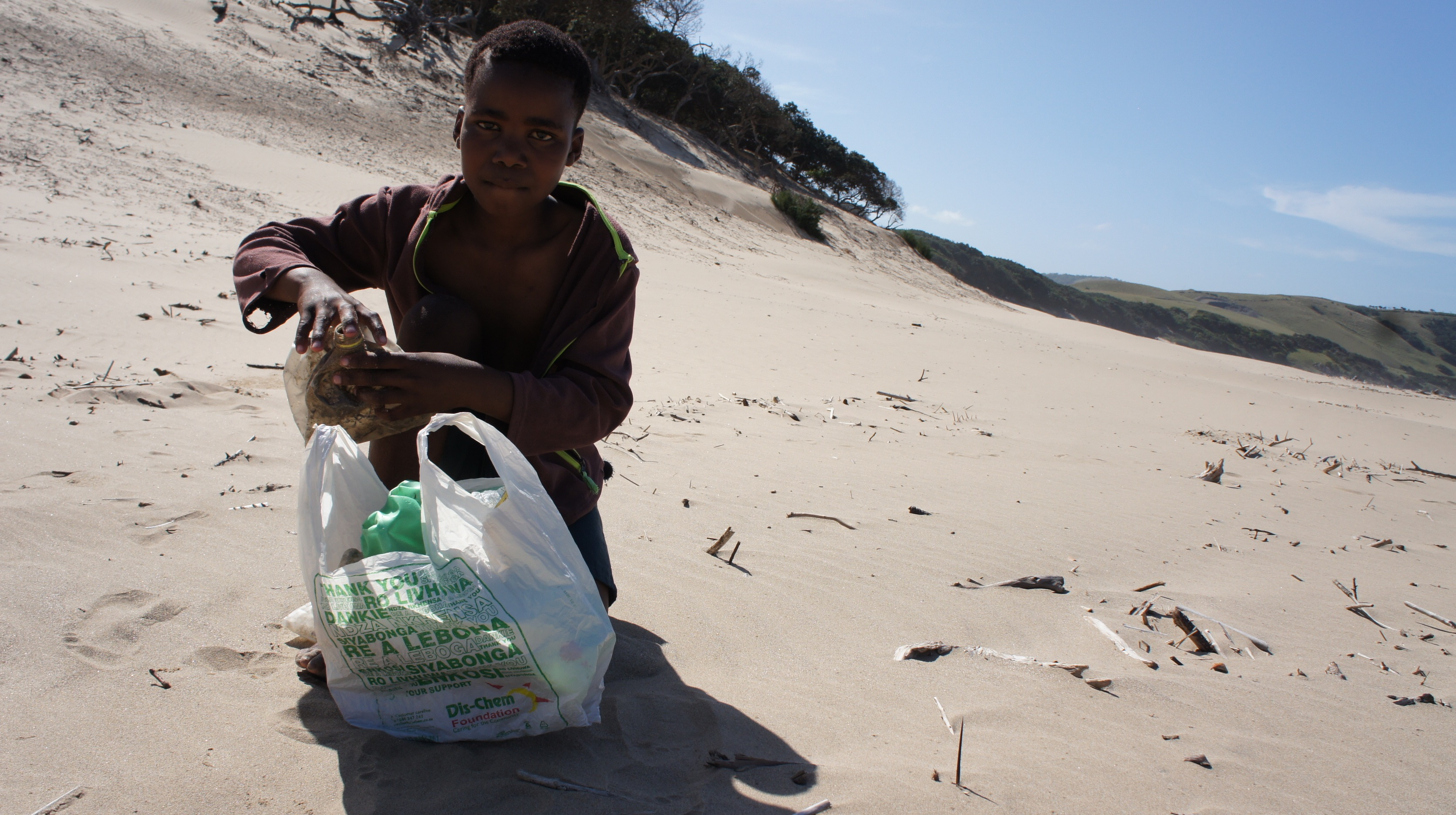 Give A Wave participant collecting trash.