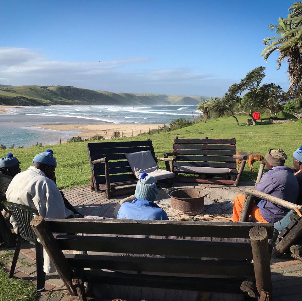 Community members relaxing at Safe Home Venue, Bulungula Lodge