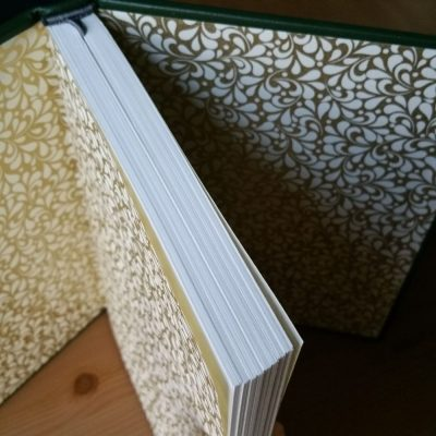 The gold and white endpapers