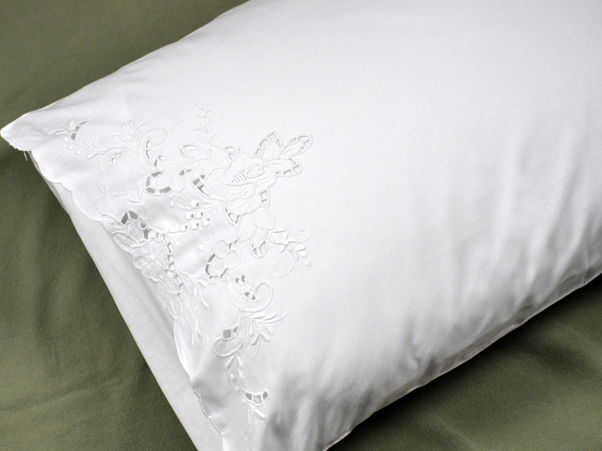 pair of linen pillowcases with rose cutwork