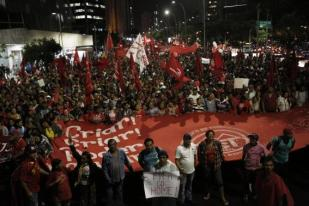 Members of Brazil's Homeless Workers' Movement walk during a protest against the World Cup in Sao Paulo