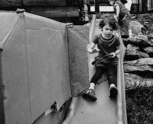 Child sliding down slide