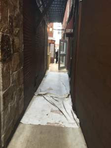 Back alley leading to Bricco Salumeria.