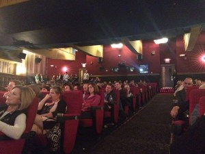 """Audience waits for the screening of """"Most Likely To Succeed"""" to begin on the opening night of GlobeDocs"""
