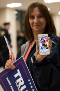 "Tyngsborough, MA, Oct 16th 2015 - Christine Goucher from Billerica shows off her phone with Donald Trump's signature on it. ""I'm here because he really feels it for the veterans"" she said at a Trump rally here on Friday. Goucher added that her son is an Afghan combat veteran who now has PTSD. (Photo by: Nikita Sampath/BUNS)"