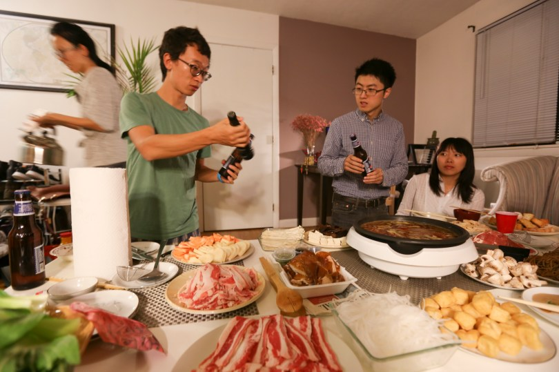 26th Nov, 2015: International students from China, Boston, India and France celebrated Thanksgiving by gatherng around a Chinese hot pot. (Photo by: Nikita Sampath/BUNS)