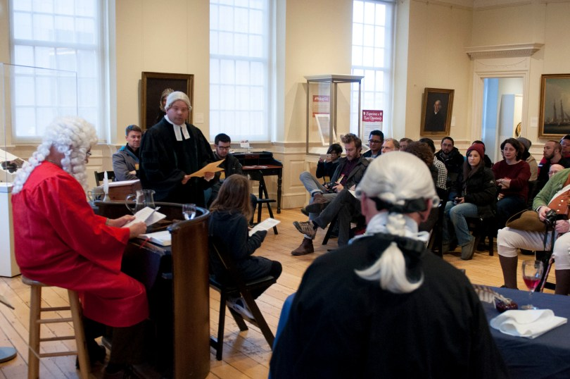 "BOSTON, March 5th, 2016: A young member of the audience joins Mike LePage (L), Paul Summers (C) and Ed Hurley (R) in the interactive play ""Trial of the Century"". The play is a part of the Old State House's program in commemoration of the Boston Massacre. (Marwa Morgan/BUNS)"