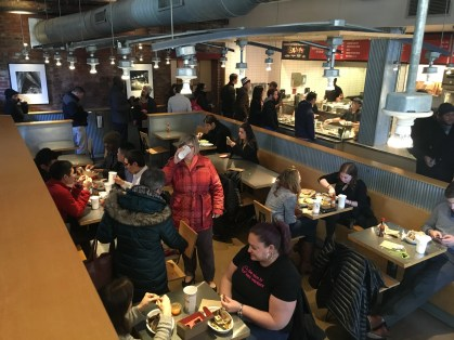 A Washington, D.C. Chipotle experiences a lunchtime rush as the company hopes to draw customers back after a series of outbreaks of food-borne illness last year. (Photo by Toni Ann Booras/BU News Service)