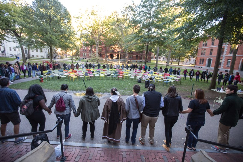 """About 100 people participated in the circle dance. After the celebration, traditional Native American foods like fry bread was served in Harvard's Ticknor Lounge. """"The culture is important,"""" said Caminsky. """"We have an identity. We're not forgotten. We're still here."""" Photo by Alexandra Wimley/BU News Service"""