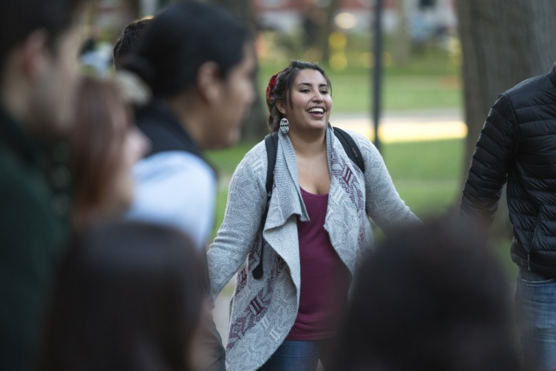Danielle Lucero, a member of Future Indigenous Educators Resisting Colonial Education (FIERCE) at Harvard University, participates in a dance to close out the celebration. Attendees held hands in a circle and danced for the duration of a song.