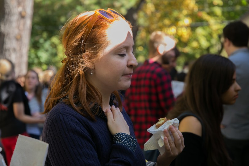 Leightcap enjoys an apple cider donut. She says that this day reminds her of the typical fall snack of her home state of Pensylvania, horseradish, pretzel and beer cheese, which come from the German heritage of some of the inhabitants of the state. Photo by Silvia Mazzocchin/BU News Service