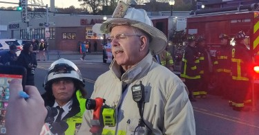 Deputy Fire Chief, Stephen Miller, addresses the media after a partial roof collapse at Common Ground Bar & Grill in Allston, Nov. 4. Photo by Aaron Ye / BU News Service.