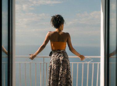 the-most-beautiful-beach-towns-near-barcelona-girl-balcony