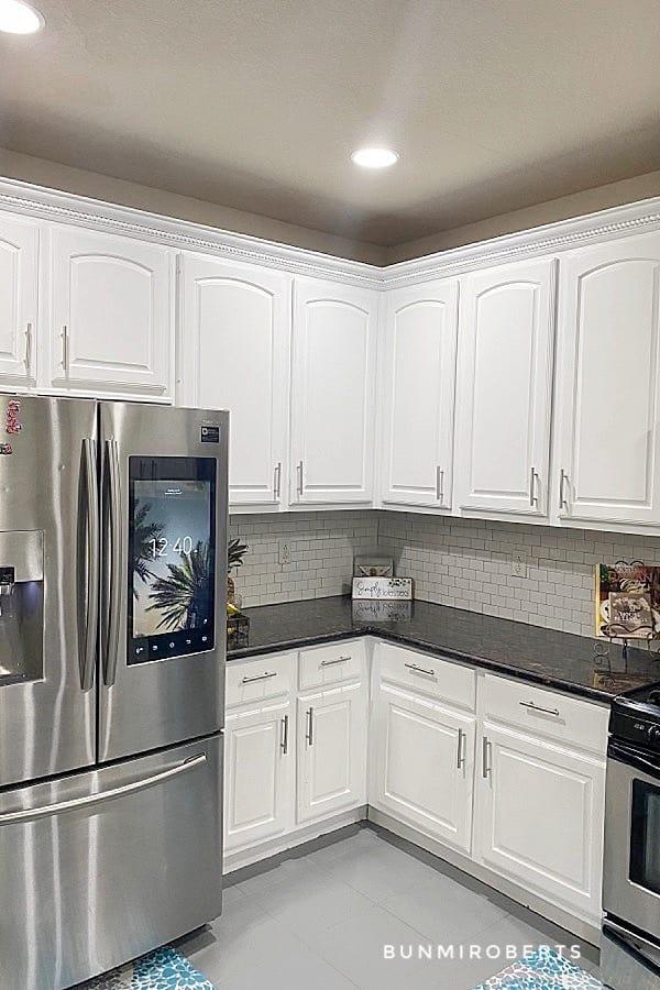 kitchen grey tile floor white cabinets